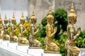 A line of beautiful Buddha statues