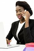 Attractive Woman Speaking on the Phone, Working on the Laptop, Isolated on White Background