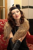 Beautiful Woman In Evening Gown And Furs In The Luxurious Interior