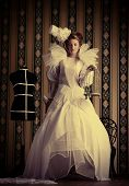 picture of mannequin  - Beautiful fashion model in the refined white dress and mannequin - JPG