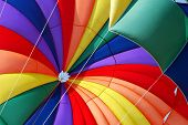 image of parasailing  - Rainbow Parachute on the beach - JPG