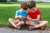 Little Boys Playing On Tablet