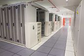 Empty hallway of server towers in large data center