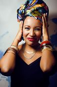 beauty bright african with creative make up, shawl on head like cubian woman