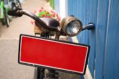 Bicycle With Red Banner Carrying Flowers Pot