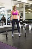Full length of a fit young woman standing in the gym