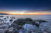 Stupendous Rocky Seacost With Silky Ocean