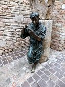 Statue Of St. Francis In The Garden Of The Monastery In Assisi,