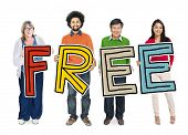 Multi-Ethnic Group of People Holding Text Freedom