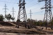 System Of Electricity Pylons And Power Lines Out-of-town