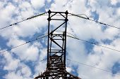 Electricity Pylon Against The Cloudy Sky Background