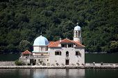 PERAST, MONTENEGRO - JUNE 08: Church of Our Lady of the Rocks. Our Lady of the Rocks is one of the two islets off the coast of Perast in Bay of Kotor, Montenegro, on Jun 08, 2012