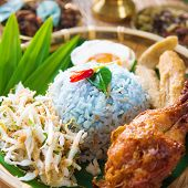 Nasi kerabu or nasi ulam, popular Malay rice dish. Blue color of rice resulting from the petals of b