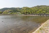 From a distance and crossing the river on Togetsukyo Bridge of Arashiyama