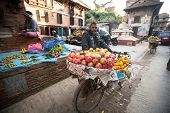 KATHMANDU, NEPAL - DEC 5, 2013: Unidentified street vendor in historic center of city. Largest city