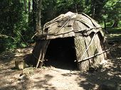 stock photo of wigwams  - A traditional Native American shelter or wigwam - JPG