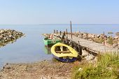 pic of suny  - boat with pier and sea on the suny day