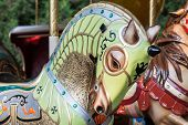 stock photo of carousel horse  - A green horse of a carousel in a park - JPG