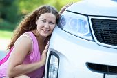 picture of pov  - Pretty girl sitting her cheek against to the bumper of the car - JPG