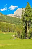 Golf course with gorgeous green over fantastic mountain view