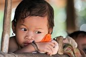 UMPHANG, THAILAND, JANUARY 17, 2006: little unidentified girl of a Karen tribe posing just after she