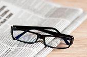Eyeglasses Lying Around Newspapers