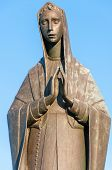 Madonna Statue With blue sky