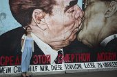 BERLIN, GERMANY - MAY 23, 2014: Fragment of graffiti (Kiss by Dm Vrubel) on Berlin Wall at East Side Gallery - it's a part of original Berlin Wall which collapsed in 1989.