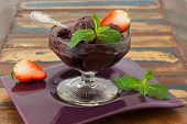 Acai pulp in glass with fresh mint and strawberry