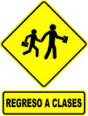 back to school sign with text in spanish