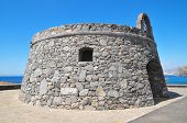 Gray Bunker on a Blue Sky