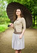 beautiful girl with umbrella in park