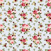 Vintage seamless pattern with pink roses on blue. Vector illustration.