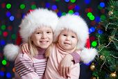 Kids In Santa Claus Hat On Bright Festive Background