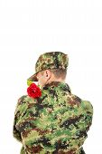 Soldier With Turned Back Holding Red Rose Over Shoulder