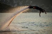 Flyboarder Diving In Perfect High Backlit Arc