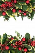 Christmas floral background border with red bauble decorations, holly, ivy, mistletoe and pine cones
