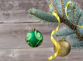 Ornaments And Ribbon Hanging On Blue Spruce Tree Branch