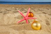 christmas balls with starfush on beach