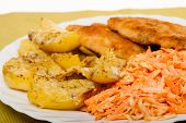 Dinner Meal. Fried Chicken Roasted Potatos And Carrot Salad.