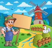 Farmer with sign near windmill - eps10 vector illustration.