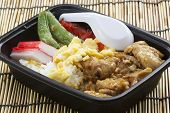 Chicken Toriyaki Rice In Plastic Box With Plastic Spoon