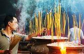 People Burn Incense At Ancient Pagoda