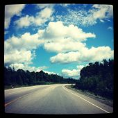 Road with blue sky and clouds - With Instagram effect