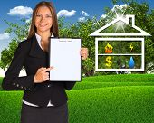 image of public housing  - Businesswoman holding paper holder - JPG