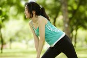 Close Up Stretching Woman In Outdoor Exercise Smiling Happy Doing Stretches In The Park.