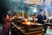 People Burn Incense At Ancient Temple