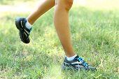 Runner feet on grass closeup