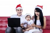 Christmas Family Playing With Laptop