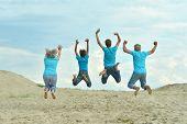 Grandparents with grandchildren jumping